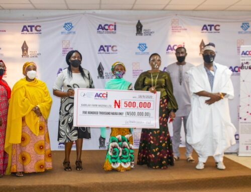 Director General, Abuja Chamber of Commerce and Industry (ACCI) Ms. Victoria Akai presenting a Business Support Grant of #500,000 to Kamilah Ahmed a 14-year old entrepreneur